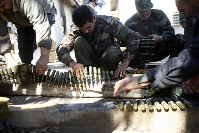 Anti-government rebels dry ammunition in a base for training and recruiting rebels for the army in Benghazi February 28, 2011.