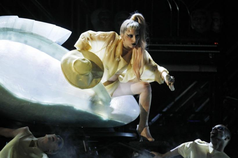 """Lady Gaga steps out of a translucent egg to perform her new song """"Born This Way"""""""