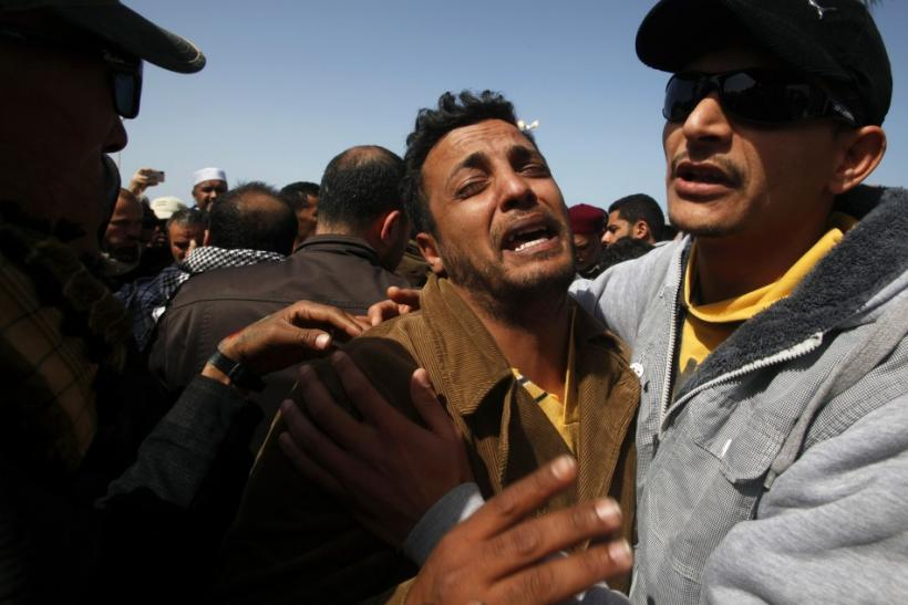 A man cries during the funeral of his relative in Benghazi