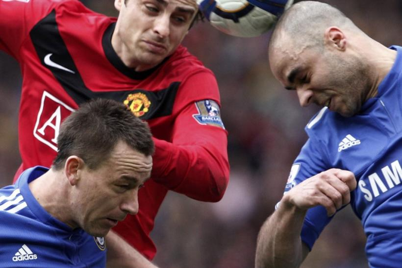 Manchester United's Berbatov challenges Chelsea's Terry and Alex during their English Premier League soccer match in Manchester.