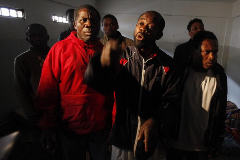 Suspected African mercenaries held by anti-government protesters stand in a room at a courthouse in Benghazi