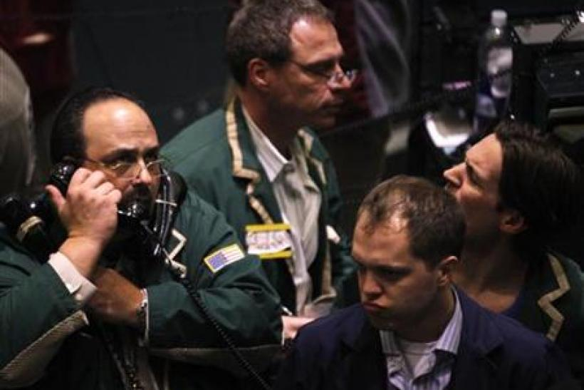 Traders work in the oil options pit on the floor of the New York Mercantile Exchange in New York