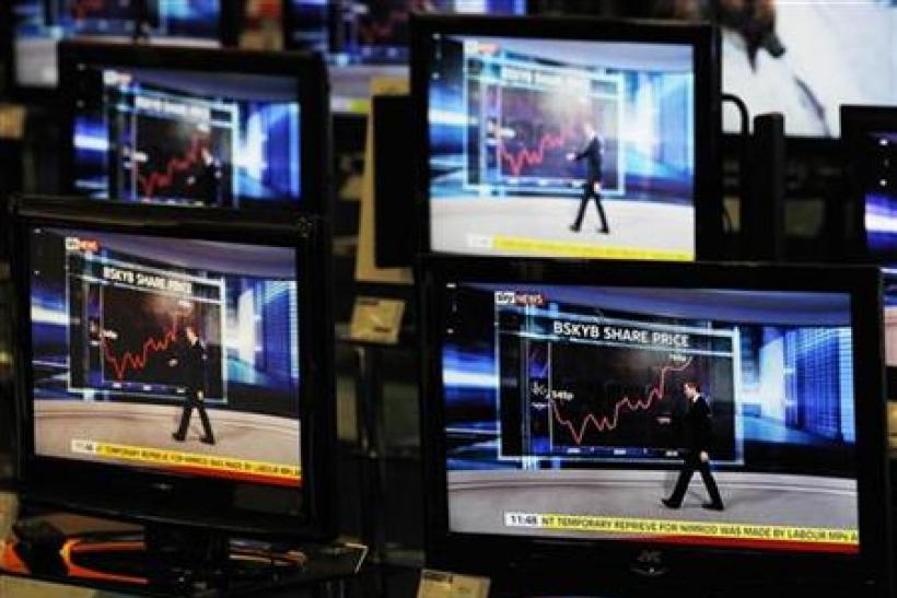 Sky News broadcast is shown on television screens in an electrical store in Edinburgh