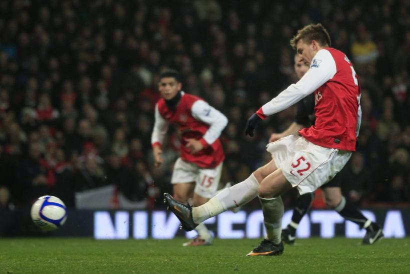 Arsenal's Nicklas Bendtner shoots and scores his third goal against Leyton Orient during their FA Cup soccer match in London.