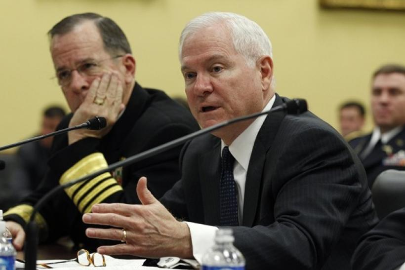 Chairman of the Joint Chiefs of Staff Admiral Mike Mullen (L) and Defense Secretary Robert Gates (R) testify during a hearing of the House Appropriations Defense Subcommittee on the budget for the Defense Department on Capitol Hill in Washington March 2,