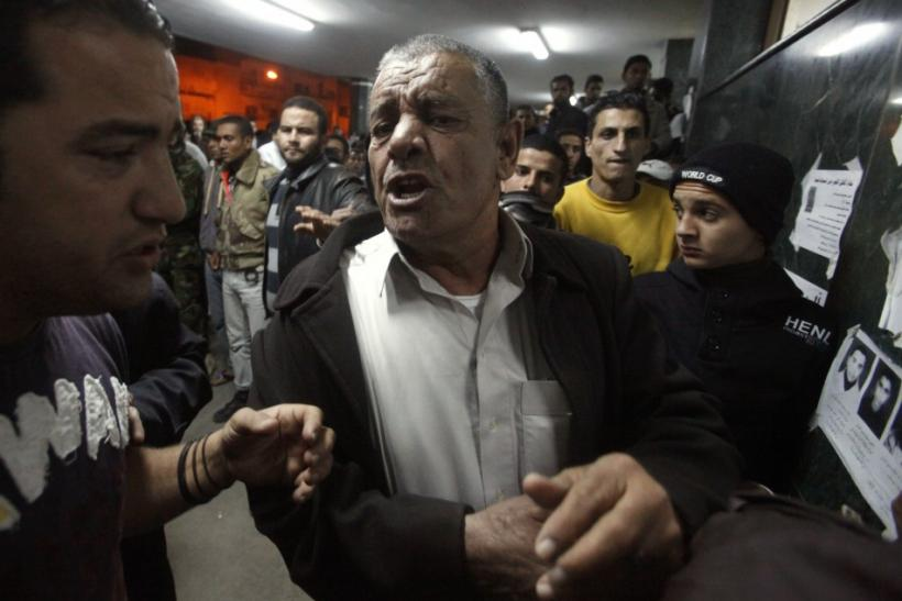 A man reacts after finding out that his relative was killed, at al-Jala hospital in Benghazi