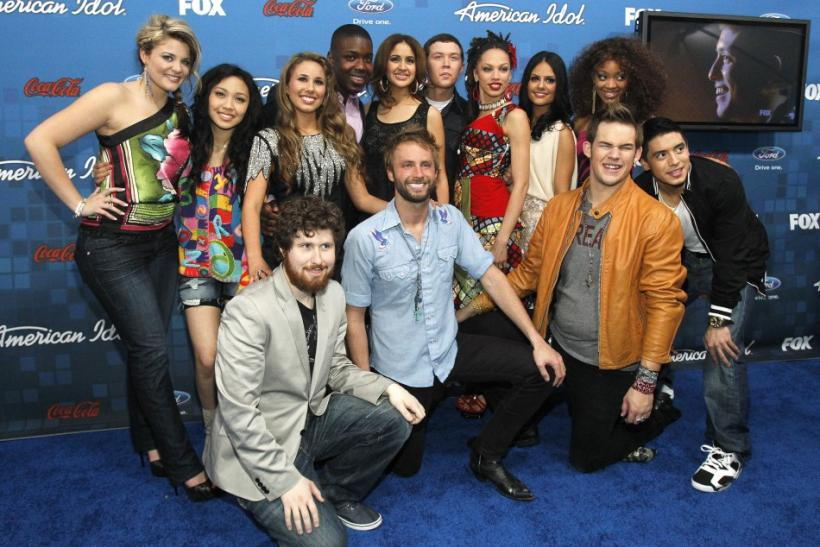 Finalists (from L-R standing) Lauren Alaina, Thia Megia, Haley Reinhart, Jacob Lusk, Karen Rodriguez, Scotty McCreery, Naima Adedapo, Pia Toscano, Ashton Jones, (from L-R front) Casey Abrams, Paul McDonald, James Durbin and Stefano Langone pose at the par