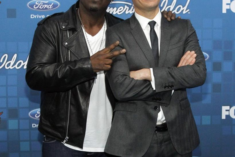 "American Idol judge Randy Jackson (L) and show host Ryan Seacrest pose at the party for the finalists of the television show ""American Idol"" in Los Angeles March 3, 2011."