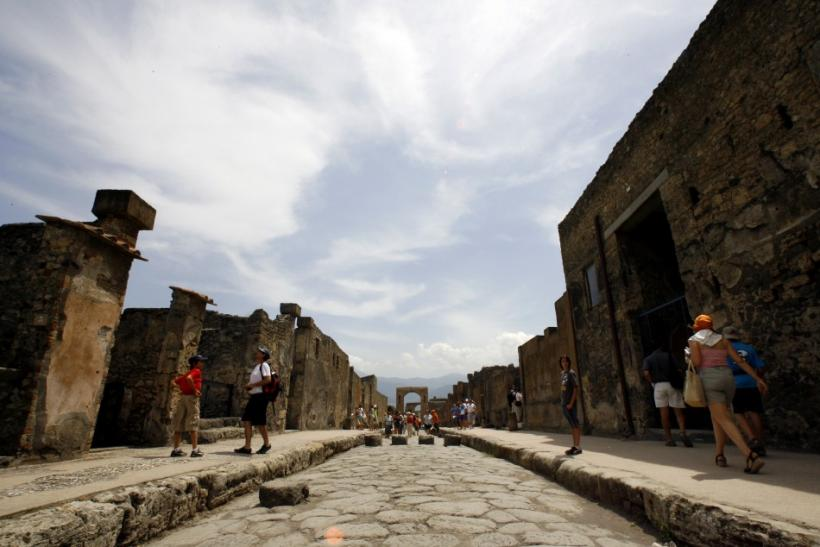 Visitors walk in Pompeii, the famous city next to Naples which was destroyed in AD 79 by the eruption of Mount Vesuvius.
