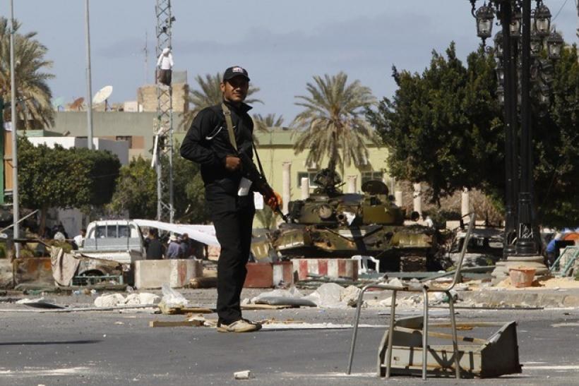 A gunman opposed to leader Muammar Gaddafi stand guard in the centre of the city of Zawiyah, 50 km (30 miles) west of the capital Tripoli, March 5, 2011. Forces loyal to Libyan leader Gaddafi launched a new attack on the western town of Zawiyah on Saturda