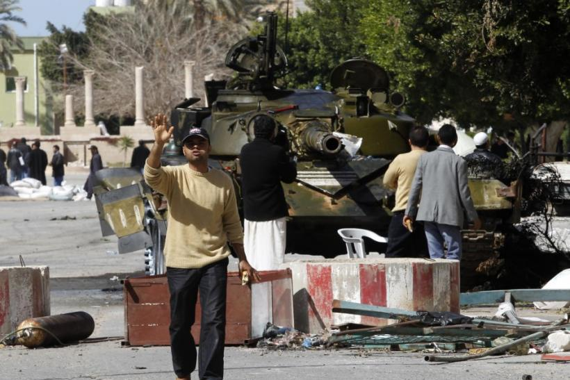 Rebels gather near a tank used by Libyan army defectors in the centre of the city of Zawiyah