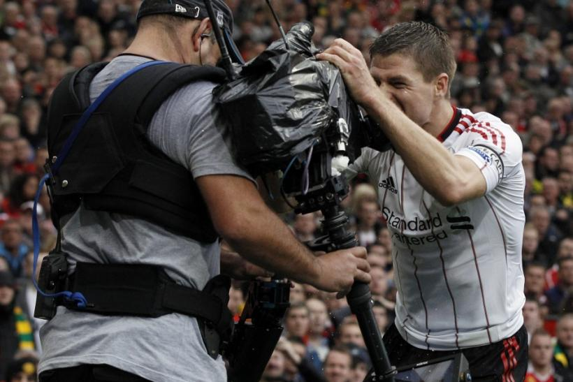Liverpool's Gerrard celebrates with a television camera after scoring his second goal during their English Premier League soccer match against Manchester United at Old Trafford in Manchester.