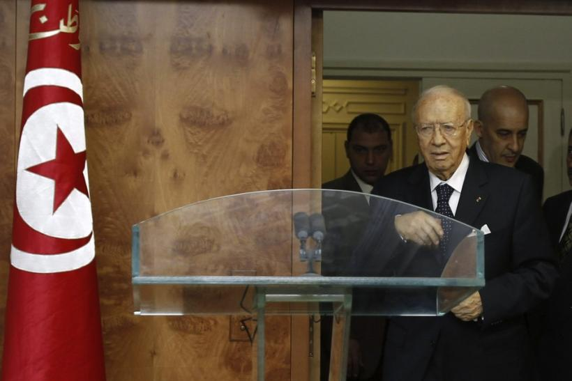 Tunisian interim prime minister Beji Caid Sebsi arrives to a news conference in Tunis