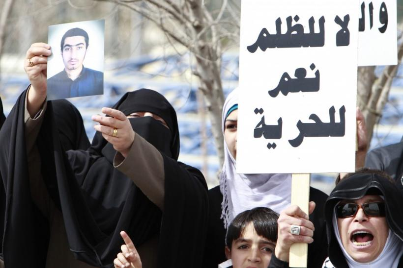 Former Islamist inmates and relatives of political detainees hold a rally demanding the release of prisoners in Amman