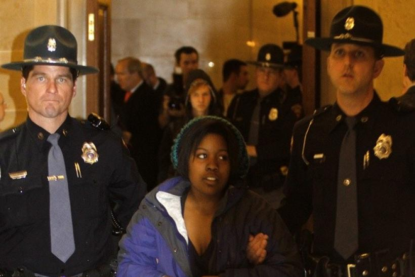 Protester Brandi Collins from Milwaukee, and a student in Madison, is physically removed by Wisconsin State Troopers from the vestibule of the State Assembly Chambers of the State Capitol in Madison, Wisconsin March 10, 2011. Dozens of protesters flooded