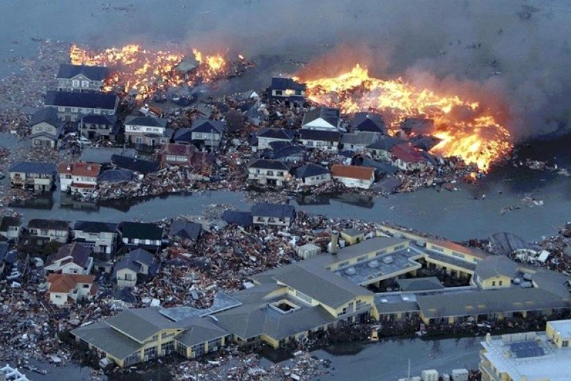 Houses swept out to sea burn following a tsunami and earthquake in Natori City in northeastern Japan March 11, 2011.