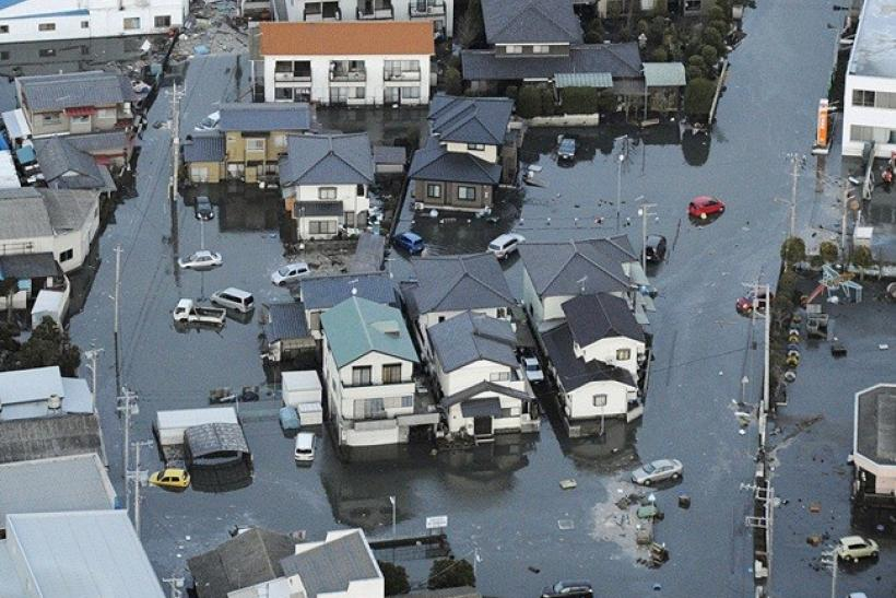Streets are flooded after an earthquake in Oarai City in Ibaragi Prefecture, northeastern Japan March 11, 2011.