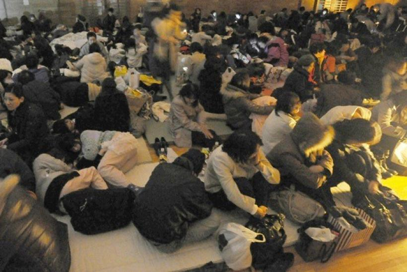 Evacuees take shelter at an evacuation centre during a blackout after an earthquake and tsunami in Sendai, northeastern Japan, March 11, 2011.