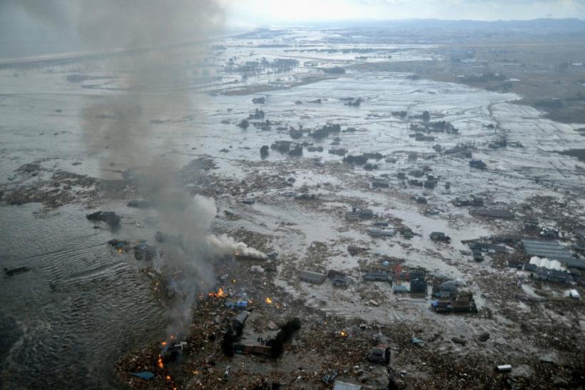Fires burn in a harbour following an earthquake and tsunami in Natori City, Miyagi Prefecture.