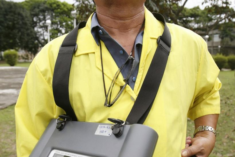 A Nuclear Research Bureau staff member from the PNRI monitor radiation levels in the air in Quezon City