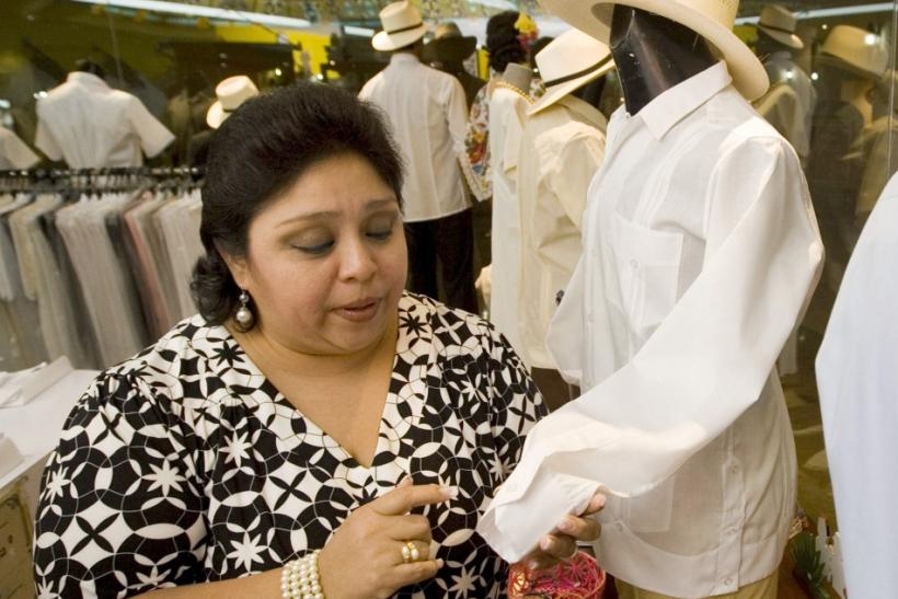 A woman looks at a guayabera shirt in a department store in Merida