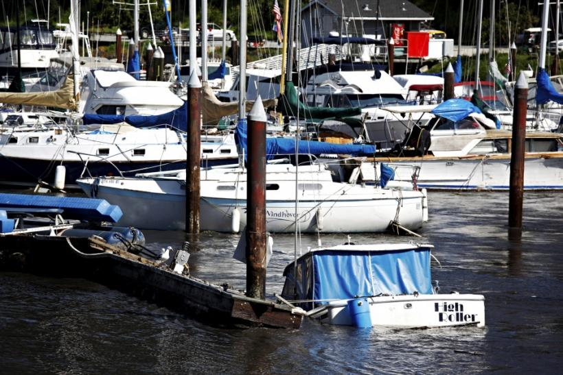 A boat begins to take in water and sink at the Santa Cruz Harbor in Santa Cruz, California