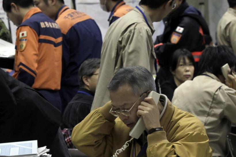 Worker at the disaster response headquarters talks on a phone in Fukushima, northern Japan