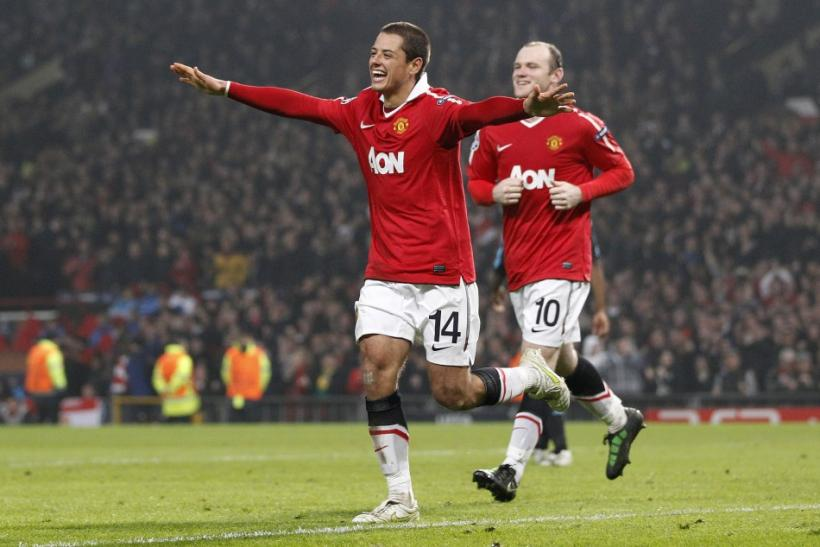 Manchester United's Hernandez celebrates with Rooney after scoring during their second leg round of sixteen Champions League soccer match against Olympique Marseille at Old Trafford in Manchester.