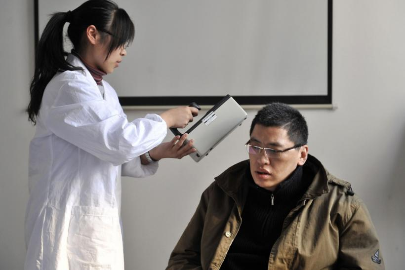 A man who just returned from Sendai gets checked for radiation levels at a research laboratory of Fudan University in Shanghai