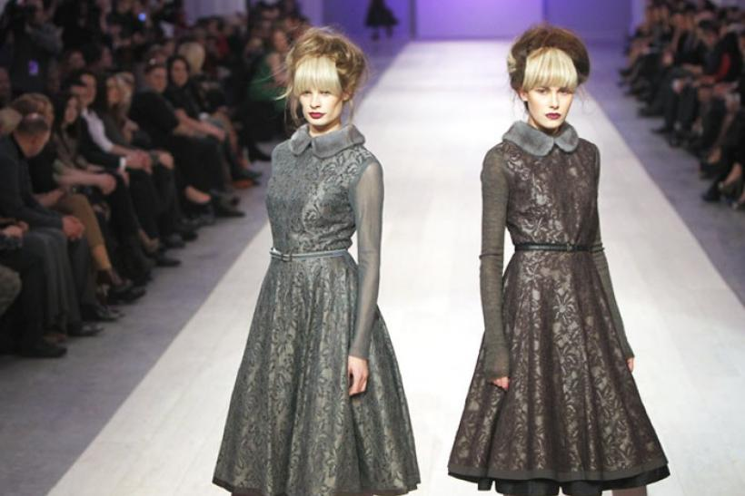 Models present creations by Ukrainian designer Gres during Ukrainian Fashion Week in Kiev