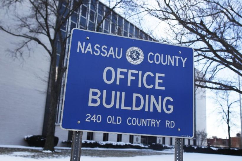 A view of the Nassau County office building sign in Mineola