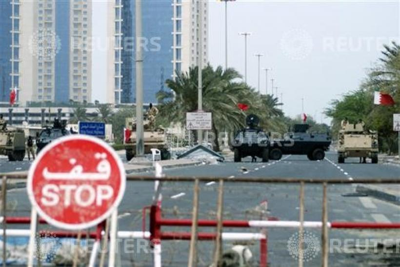 Armoured vehicles belonging to Gulf Cooperation Council military forces guard the entrance to Pearl Square in Manama