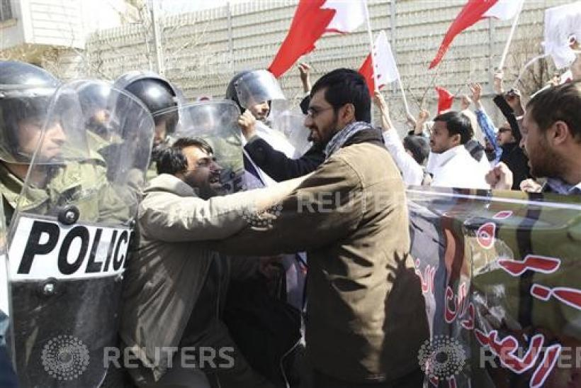 A man tries to push through police lines in front of the Saudi embassy in Tehran