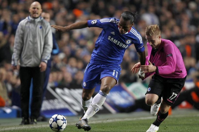 Chelsea's Drogba is challenged by FC Copenhagen's Oscar Wendt during their Champions League round of 16 second leg soccer match at Stamford Bridge in London.