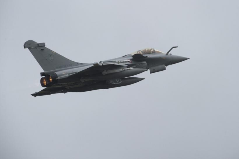 French Dassault Rafale combat aircraft, seen in this photo released by ECPAD, is in flight after taking off from Saint-Dizier military base