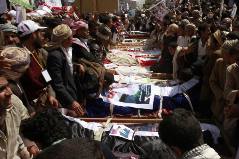 Mourners gather around the coffins of anti-government protesters during a funeral in Sanaa March 20, 2011.
