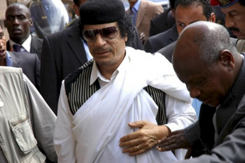 Libya's President Gaddafi arrives for the official opening of the Gaddafi National mosque in Uganda's capital Kampala