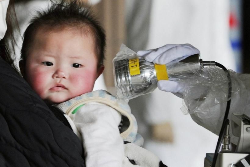 A baby undergoes a check for radiation in Fukushima City, northeastern Japan