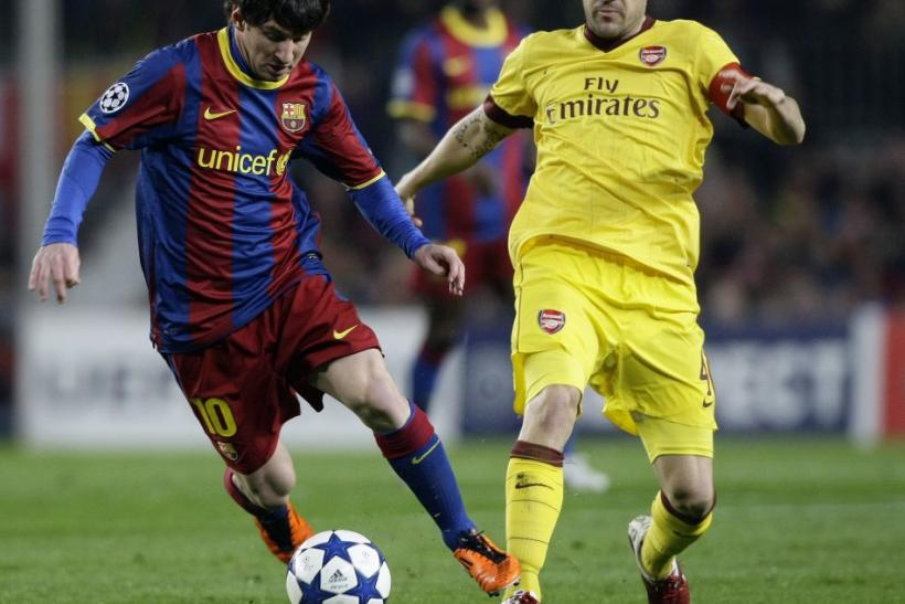 Barcelona's Messi controls the ball challenged by Arsenal's Fabregas during their Champions League soccer match in Barcelona.