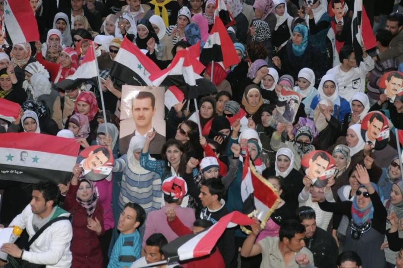 Supporters of Syria's President Bashar al-Assad shout slogans in Syria's northern city of Aleppo