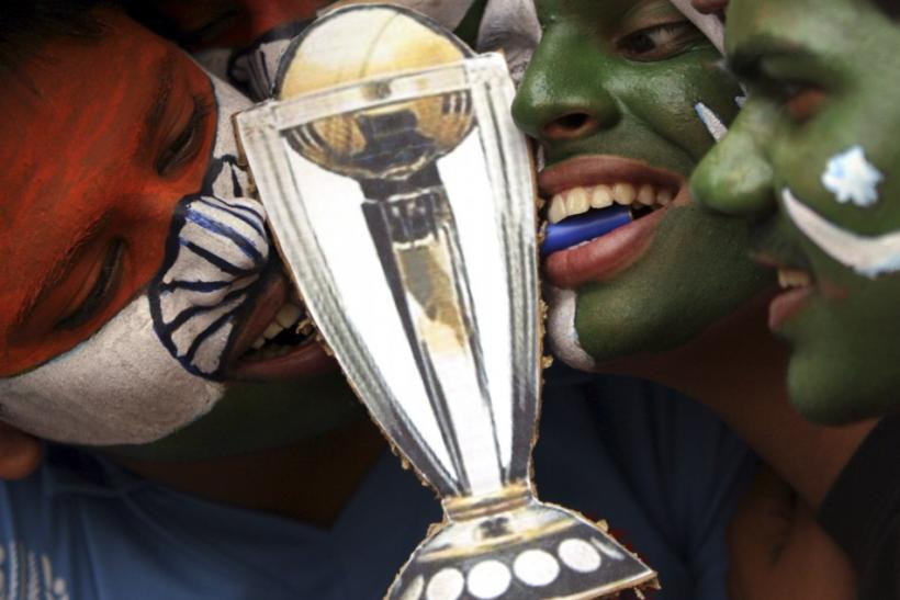 Cricket fans with their faces painted with the Indian and Pakistani national flags pose in Hyderabad.