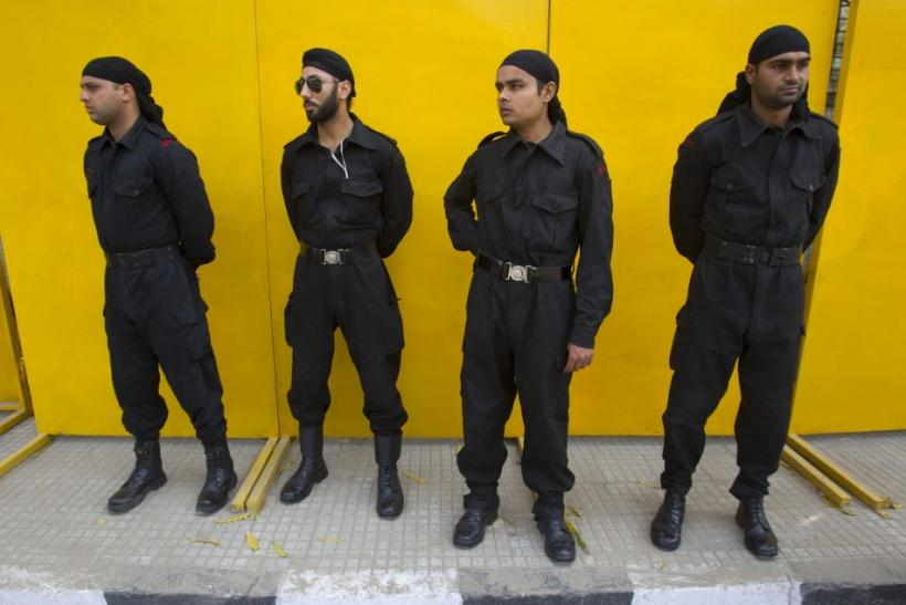 Police commandos stand guard outside the Punjab Cricket Association stadium ahead of India's ICC Cricket World Cup semi-final match against Pakistan in Mohali.