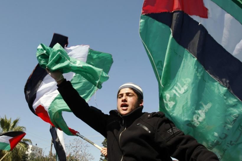 Palestinian shout slogans during a rally in Gaza City