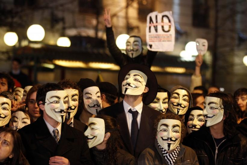 Protestors wearing Fawkes masks