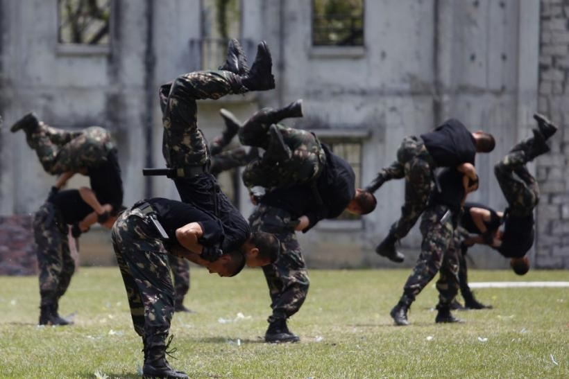 People's Liberation Army soldiers demonstrate martial arts during an open day of their barracks in Hong Kong