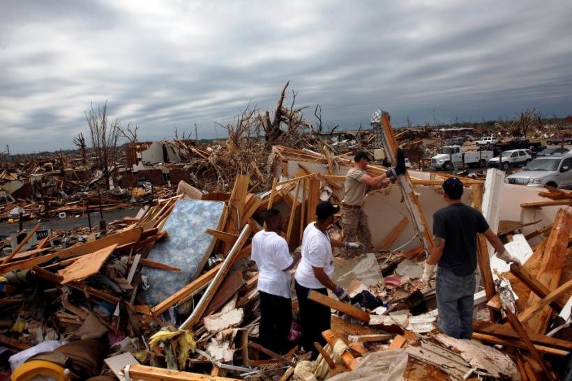 Residents look for belongings from a destroyed apartment building in Joplin, Missouri