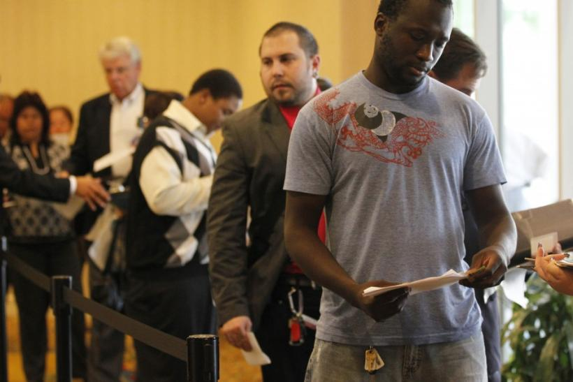 People wait in line to attend a job fair for military veterans and other unemployed people in Los Angeles