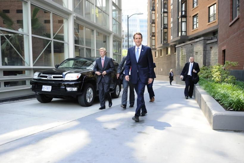 Pawlenty walks with staffers to hold a news conference after speaking at the Cato Institute in Washington