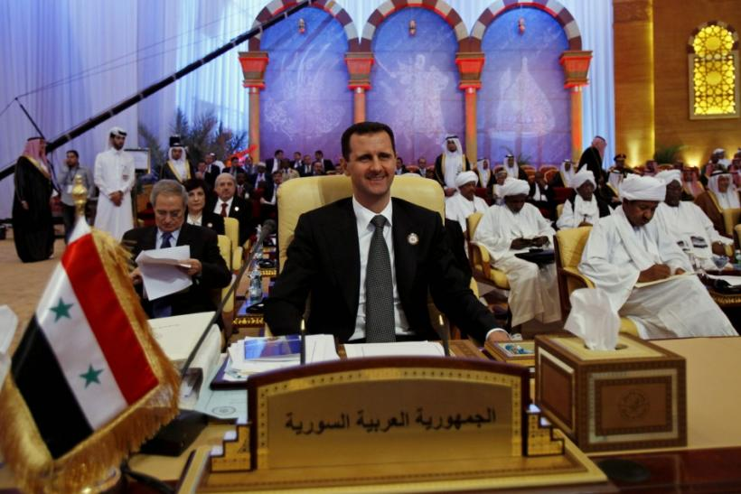 Syria's President Assad attends the final session of an Arab summit in Doha