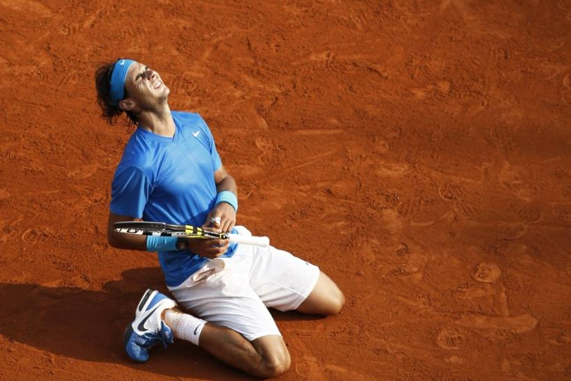 Nadal of Spain reacts after defeating Federer of Switzerland